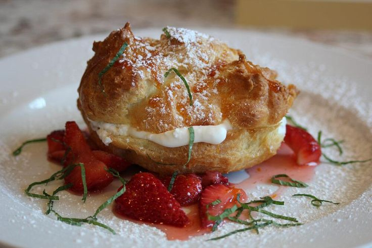 cream puff with vanilla whipped cream, sugar caramel, strawberry and mint
