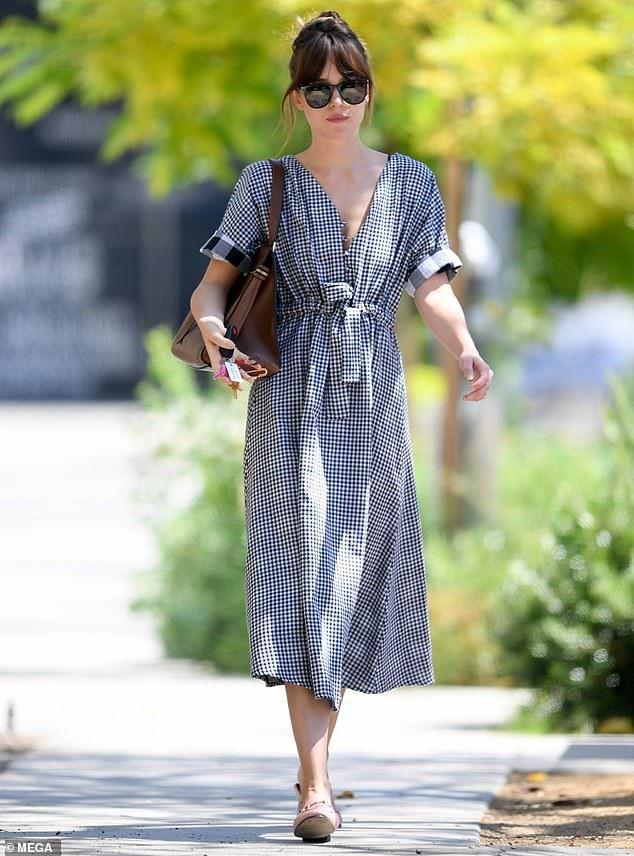 Dakota Johnson looks elegant in a pretty gingham summer dress