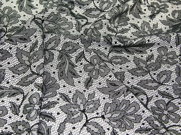 """LOVE this lace print velvet touch jersey fabric - just £6.99 per metre (60"""" wide). Only whilst stocks last as it is from our clearance range. Online special only. For more details please view the fabric on our website here; http://www.minervacrafts.com/products/9.c-28-blackwhite-velvet-print-stretch-jersey-clearance-dress-fabric-per-metre.html"""