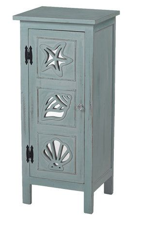 Dark aqua cabinet with beach designs on drawers