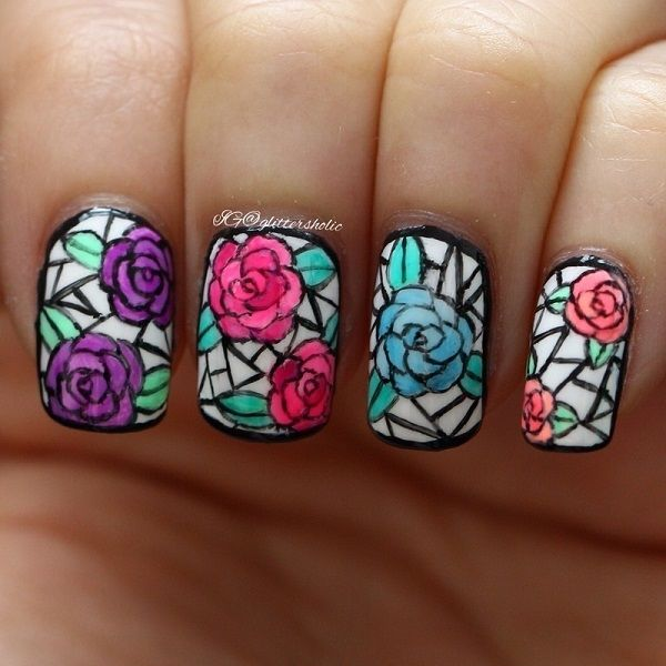 Mosaic themed rose nail art design. The roses are drawn in classic mosaic design which looks like blocks being formed together. It gives a beautiful impression of the roses and makes a simple yet quirky nail art design.