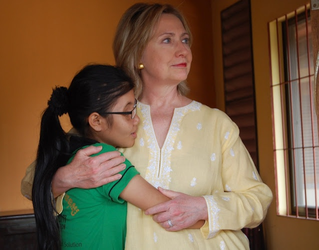 The girl on the left, Somana, is a wonderful, courageous girl who was kidnapped and sold to a brothel at 14. The brothel gouged out her eye as punishment when she complained. After we wrote about her, Secretary of State Hillary Clinton visited her on a trip to Cambodia--and the visit reverberated through the Cambodian bureaucracy. The message was that maybe these girls matter after all, if America cares about them.
