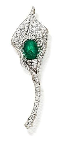 An emerald and diamond brooch/pendant                                                                                                                                                                                 More