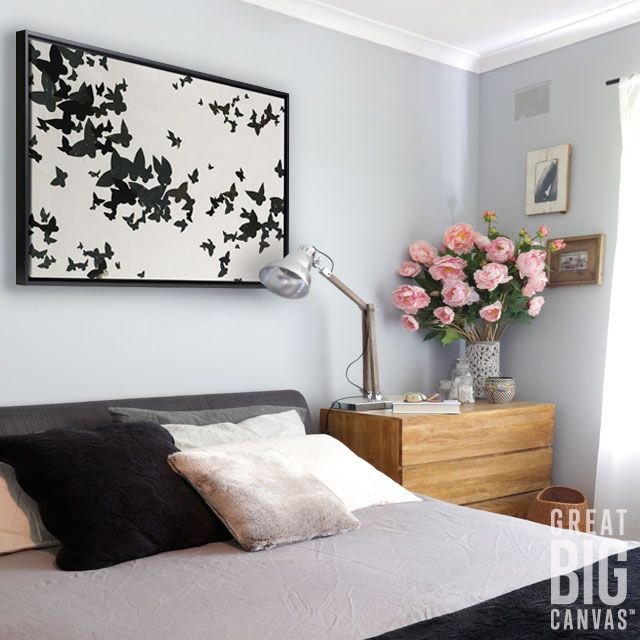 Let your bedroom décor take flight with a large minimalistic canvas print like winged