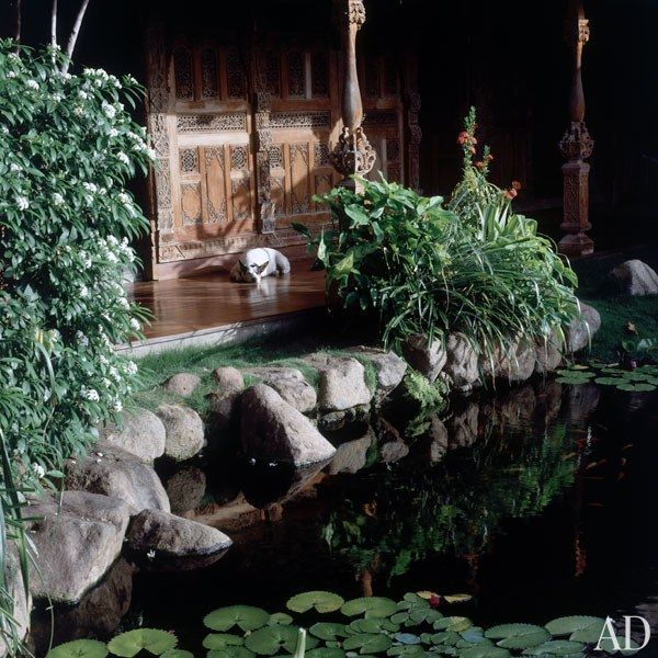 """""""By the stone entrance is a 19th-century teak carved wall known as a 'pateanaring panel,' which is an internal wall from a traditional house in central Java,"""" explains Garland."""