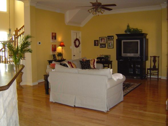 Family Room Finished Pale Yellow Walls With Black Cream