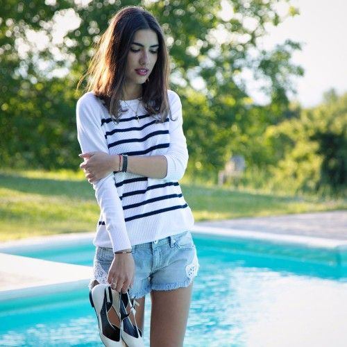 To chill out at the pool side for a break from the Mugello MotoGP, #PatriciaManfield, the fashion blogger behind #TheAtelier, wore a total look by #GasJeans, consisting of a bréton striped lightweight sweater and a pair of denim cutoffs with crochet detailing.