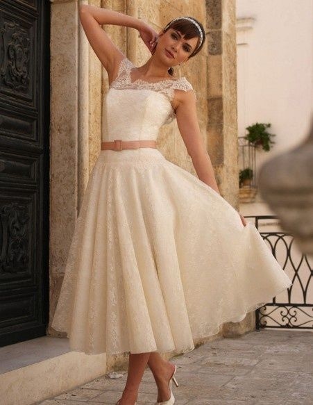 cute 50s style wedding dress. Sometimes I really like the idea of a short dress like this with a vintage theme.