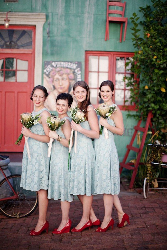 Pale blue bridesmaid dresses with rustic white bouquets and red shoes