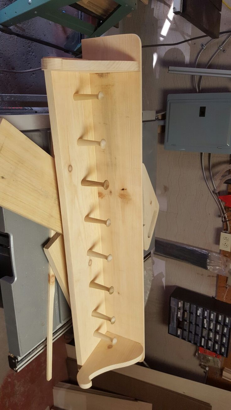Wooden coat rack shelf.
