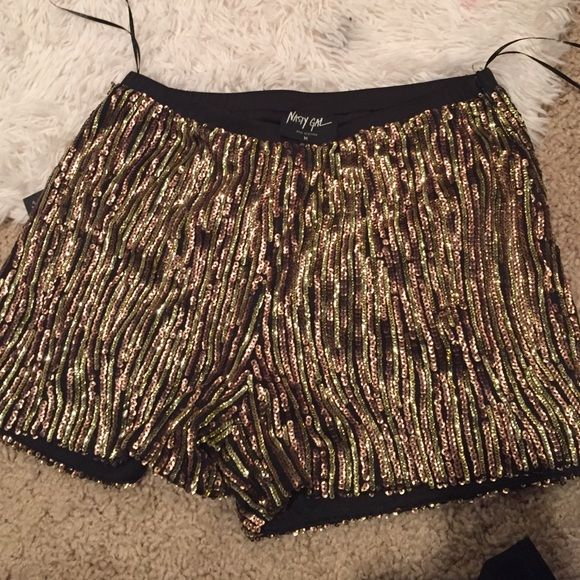 Nast gal high waist shorts From Nast gal brand new! Sparkly new with tab high waisted Nasty Gal Shorts Skorts