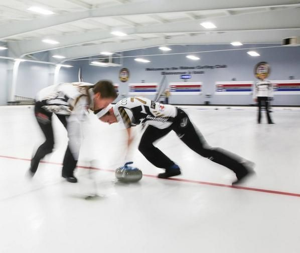 Jo and miskew sweeping in practice at the Ottawa curling club