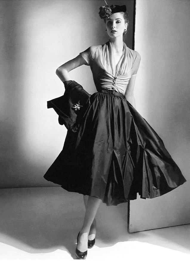 Suzy Parker wearing an afternoon dress from Dior Haute Couture in a photo by Horst P. Horst, Paris, 1952
