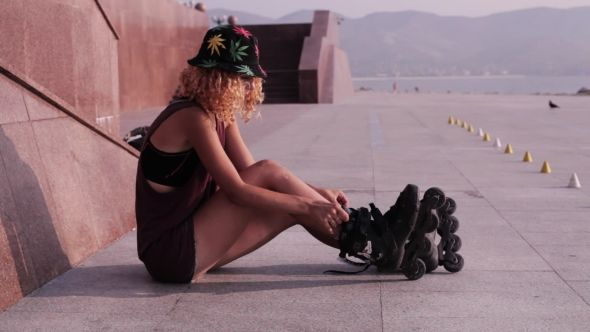 Cute Teen Girl Puts On Roller Skates At Seafront #Activity, #Adult, #Afternoon, #AlexEg, #Alley, #Autumn, #Bicycle, #Female, #Fun, #Girl, #Healthy, #Leisure, #Outdoor, #Park, #Roller, #Young https://goo.gl/MfrRJD