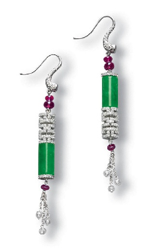 A PAIR OF JADEITE, RUBY AND DIAMOND EAR PENDANTS    Each bezel-set with a brilliant-cut diamond surmount, to the ruby beads and a jadeite cylinder of intense green colour and moderate translucency, between a pavé-set diamond geometric openwork link, with a ruby and diamond bead tassel, mounted in 18k white gold, cylinders approximately 11.94 x 6.43 and 12.31 x 6.44 mm, ear pendant 7 cm long