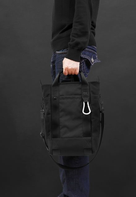 Vertical Laptop Tote was designed for maneuvering around town with a variety of…