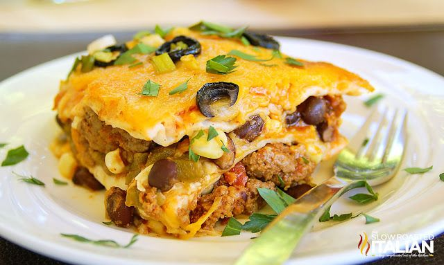 Mexican Lasagna is made with layer upon layer of spectacular south-of-the-border flavors. A drool worthy dish with just enough heat to wake up your taste buds, you will surely beat the picky palates in your house with this fabulous casserole that takes 15 minutes of prep and 15 minutes to bake.