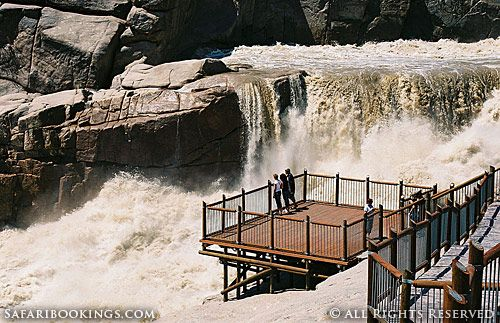 Tourists viewing the falls of Augrabies Falls National Park in South Africa. For a #Augrabies travel guide visit www.safaribookings.com/augrabies. With best time to visit, maps, reviews photos and more!