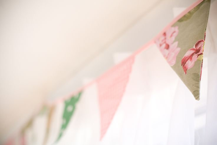 Bunting over window treatments