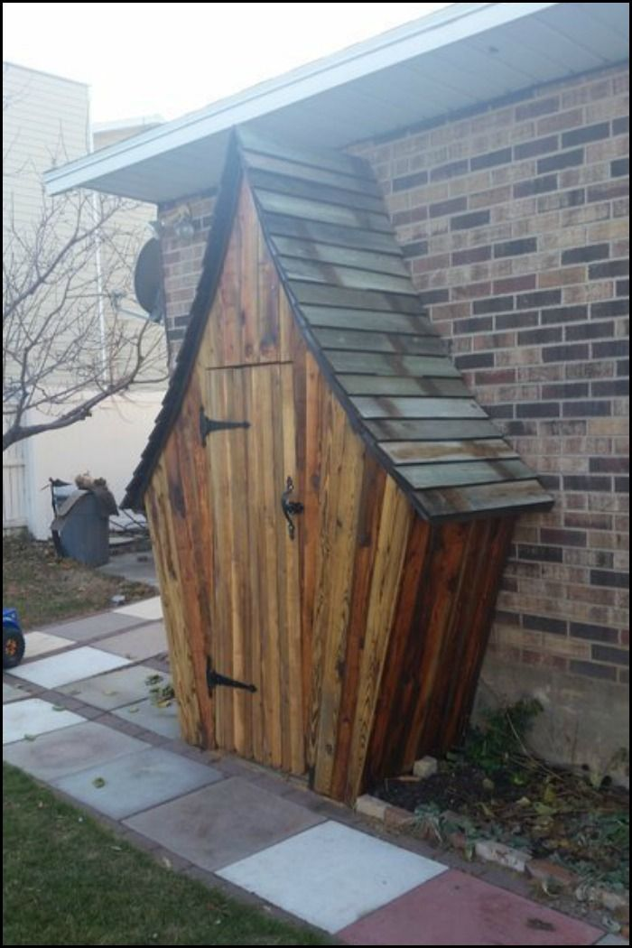 Keep your garden tools organized in this whimsical DIY garden tool shed!