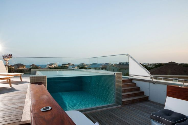 rooftop pool lounge chair wooden deck glass siding tiled wall of Getting Inspired by 10 Stunning Ideas of Modern Swimming Pool