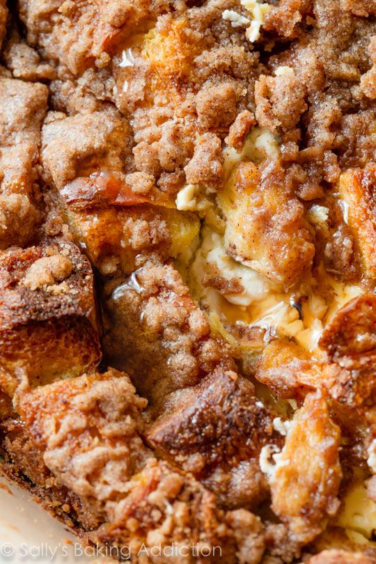 The BEST overnight french toast casserole you will ever have. Stuffed with sweet cream cheese and topped with streusel!!