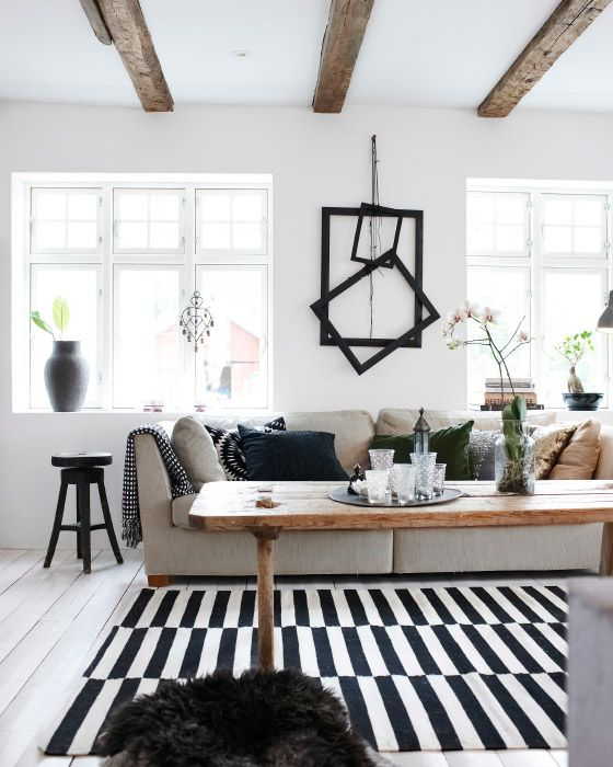 A bold monochrome theme and striking details bring the room together