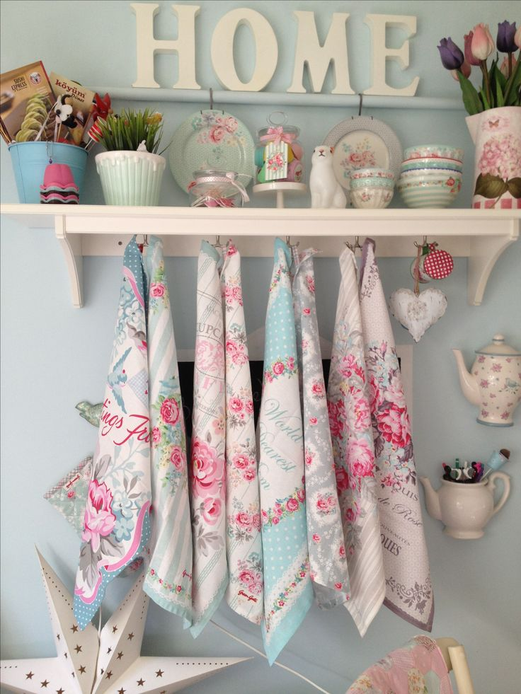 Most people don't display all of their tea towels but I think this is a nice idea, hanging cath kidston tea towels on the wall would look lovely and fresh