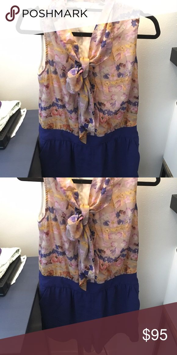 Silk Floral Ted Baker Romper Size 3 (large) Ted Baker romper. Silk top features button closure down the front and two silk pieces attached to the collar which can be tied into a bow in the front, tied in the back for an open collar, or left open. Blue shorts are attached at the bottom. Zipper goes up the side for easy wearing. Worn once, excellent condition, non-smoking environment. Ted Baker Other