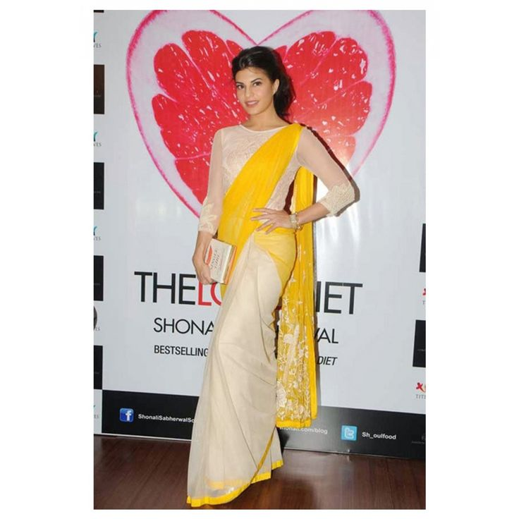 Jacqueline Fernandez Yellow Saree At Launch Book The Love Diet To Buy online Click http://trendzila.com/bollywood/283--jacqueline-fernandez-yellow-saree-at-launch-book-the-love-diet.html?search_query=355&results=1