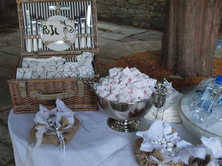Wedding compliment table with rice, dragies, sweets and cold water.