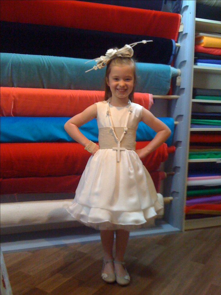 Communion dress, head piece and accerssories made by dress maker Denise Long. Designed by childs mother. Silk and linen from CLOTH Dublin