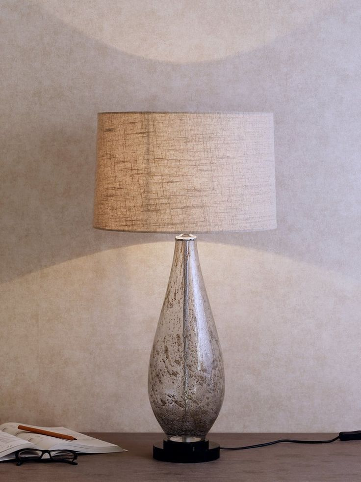 Bovolo infuse your space with contemporary brilliance this smoky mercury glass bovolo table lamp