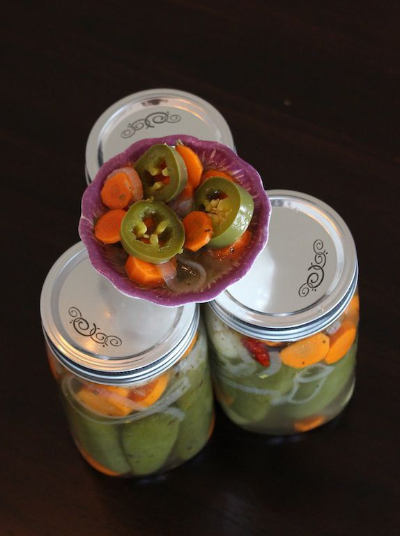 Pickled jalapenos | Jalapeños en vinagre: Pickled jalapeños are available at most local grocery stores, but this homemade version is truly a spicy treat!