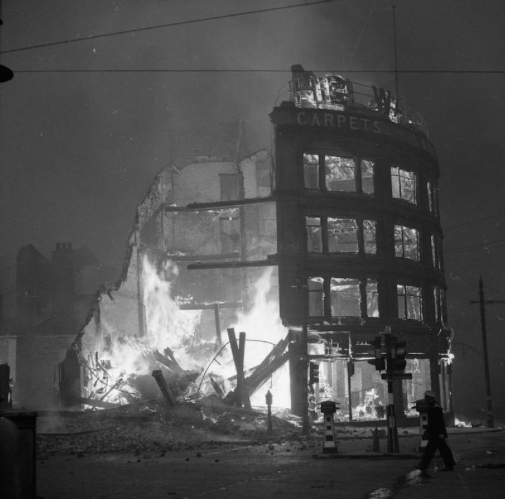 "Buildings burning in Manchester after a German air raid on the night of 3 December 1940 ~ part of ""WAR OFFICE SECOND WORLD WAR OFFICIAL COLLECTION"""