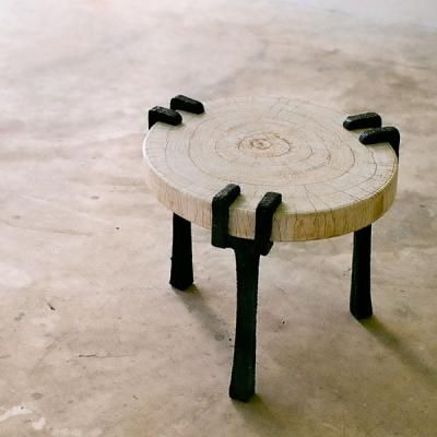 vesper low table by alexander lamont caste bronze tapered legs that support a top made from precious materials