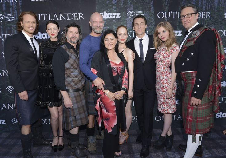 "Actors Sam Heughan and Caitriona Balfe, executive producer Ronald S. Moore, actor Graham McTavish, author Diana Gabaldon and actors Lotte Verbeek, Tobias Menzies and Nell Hudson and managing director of Starz Carmi Zlotnik attend the Starz Series ""Outlander"" Premiere - Comic-Con International 2014 at Spreckels Theatre on July 25, 2014 in San Diego, California."