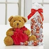 Lindt Bear with Truffles The Lindt Loveable Holiday Bear is an adorable plush teddy bear and more! This soft teddy bear has a red bow around its neck and the Lindt logo embroidered on its right foot, and arrives with an Ultimate Gift Bag filled with 28 lu