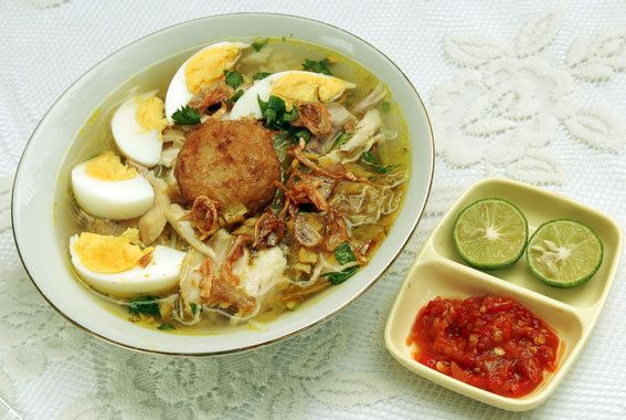 Soto Banjar, yellow chicken soup with boiled eggs and potato fritters from Banjarmasin, South Kalimantan