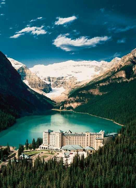 The Fairmont Chateau~Lake Louise Canada. I was here in the middle of winter so the lake was frozen...I've got a picture standing on frozen Lake Louise. It is stunning!
