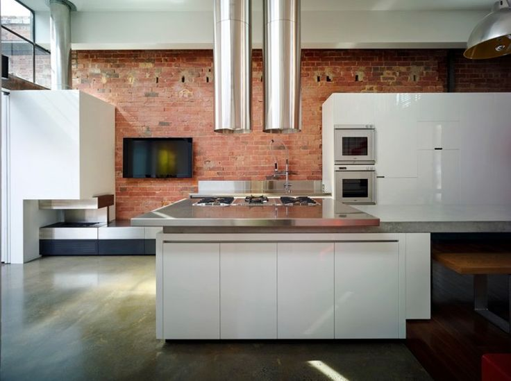 Melbourne terrace home, Andrew Maynard - white kitchen, stainless steel with red bricks and raw cement flooring