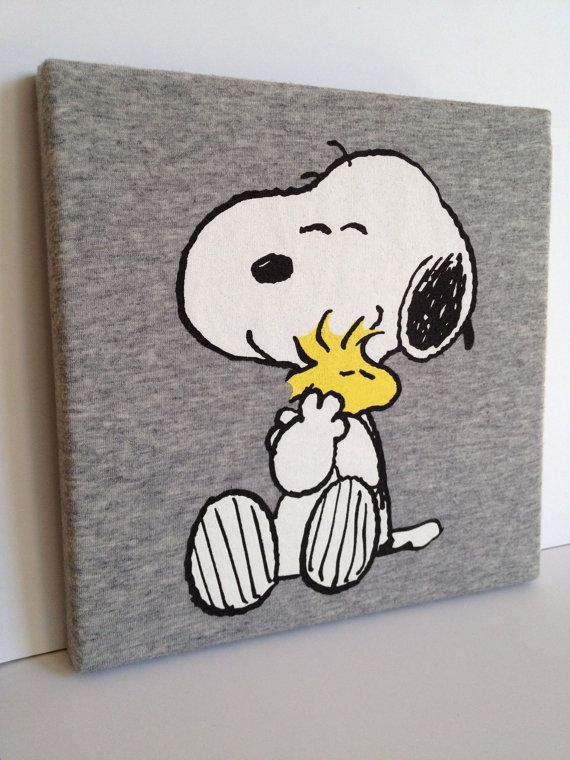 T-shirt Canvas Wall Art - Snoopy & Woodstock Peanuts Old tshirts stretched over frames or canvas' kids room maybe??