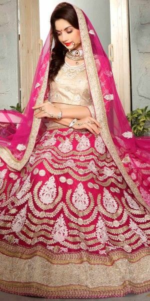 Enticing Pink Net Lehenga Choli.
