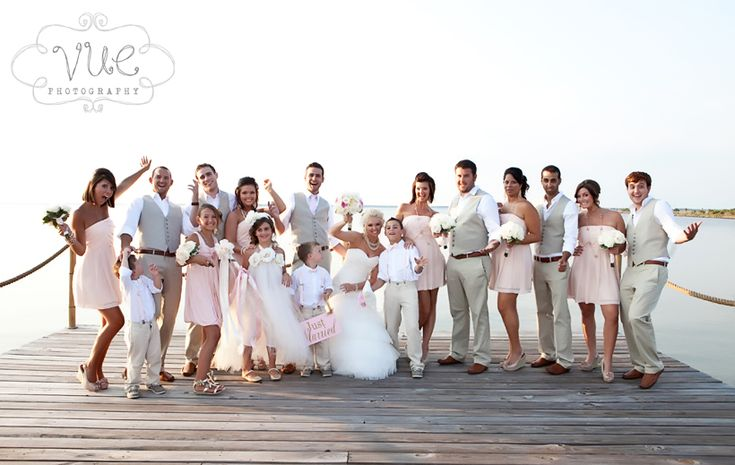 If the guys wear grey, consider putting the girls in shades of pink! (espeicially if this is a beach wedding in cali)