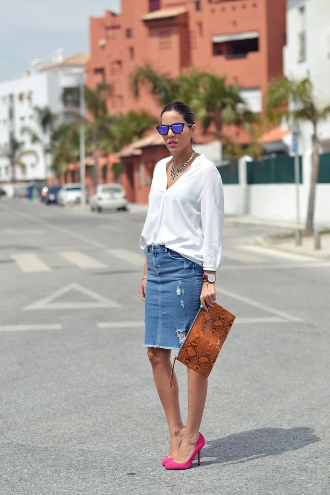 Denim skirt and loose blouse with some flashy heels and statement necklace - LOVE!