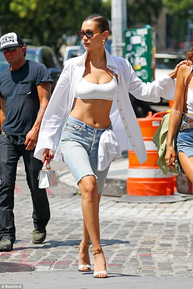 She's hot... literally:When in NYC on Thursday, the 20-year-old Nike Cortese model took off her T-shirt and put it in the belt hole of her cut-off jeans