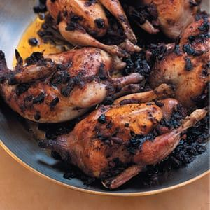 Roast quail with harissa and pomegranate seeds.