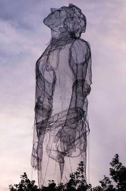 Edoardo Tresoldi sculpture towers over trees in Roskilde, Denmark, 7/15 (LP)