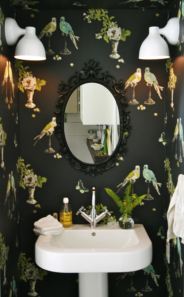 "Quarter bath: Statement wall paper, framed wall mirror and hand towel rod // Nina Campbell's ""Perroquet"" wallpaper."