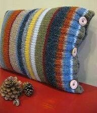 Old sweater makes a pillow cover.